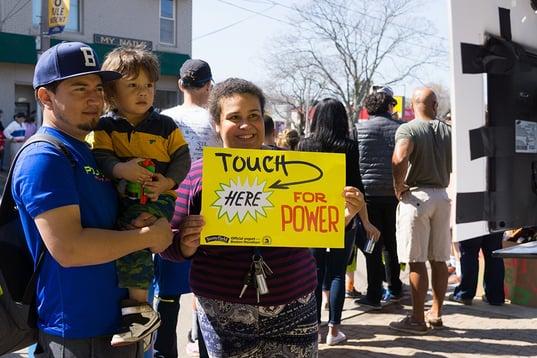 Fans holding signs Boston Marathon